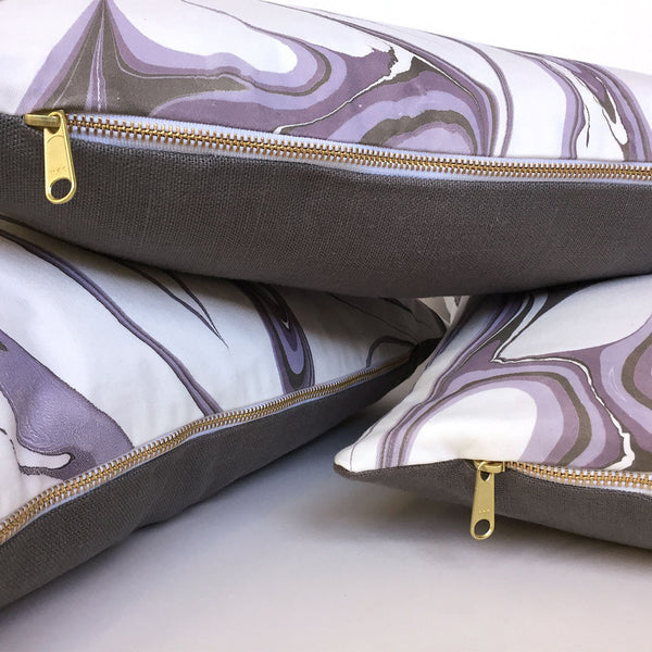 Hand made marbled pillows with gold zippers, organic cotton front, and linen back.