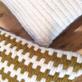 Super soft artisan made hand-stitched textured pillows. Ochre stripe and Herringbone cream.