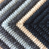 Close up view of needlepoint for Navy Blue Cross cushion.
