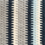 Close up of needlepoint stitches for navy blue and gray stripe cushion.