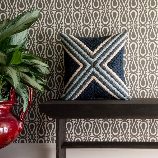 Navy Blue Cross Textured pillow shown with gray block printed wallpaper.
