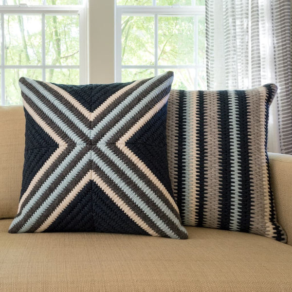 "Navy blue cross textured pillow and navy blue stripe textured pillow. Each 20""x20"""