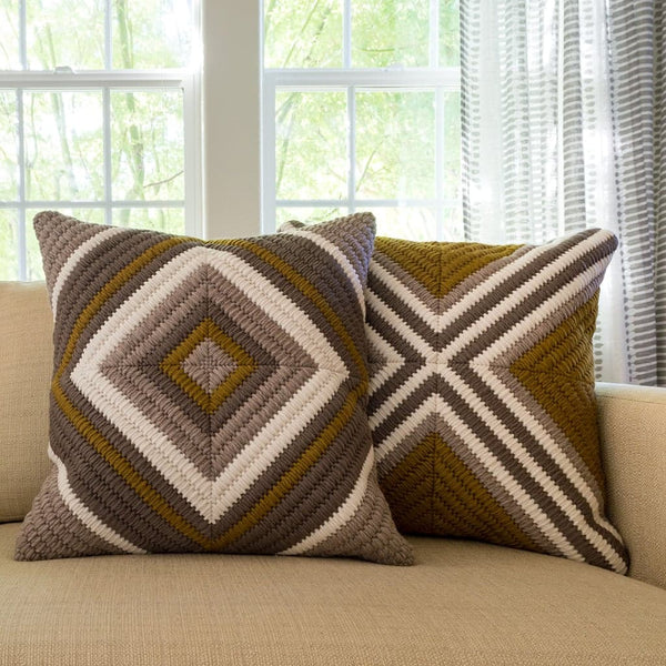 "Ochre Diamond and Ochre Cross throw pillows. Each 20""x20""."