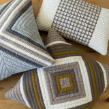 Hand stitched needlepoint modern throw pillows.