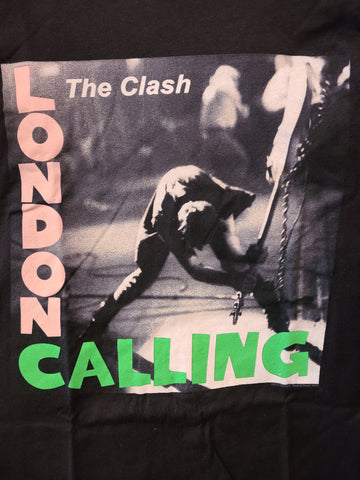 clash london calling black tshirt pink and green print and smashing guitar album cover art