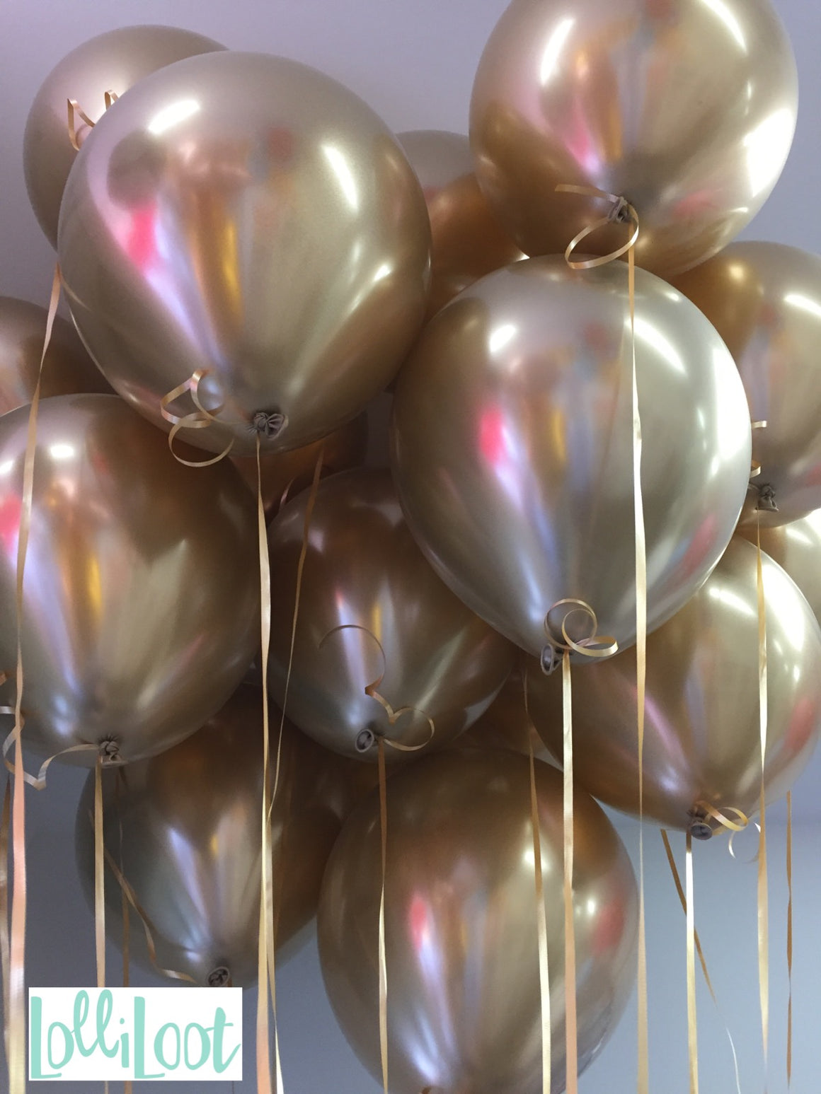 Bunch of gold chrome balloons