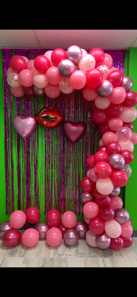 Shades of pink with confetti balloon garland - ready for you to hang