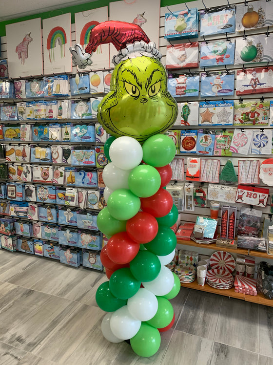 The grinch balloon pillar
