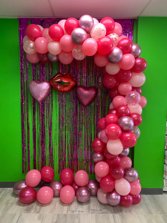 Shades of pink with confetti balloon garland