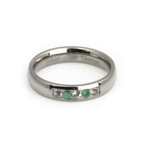 women titanium wedding ring with emerald