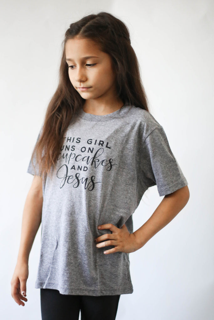 """This Girl Runs on Cupcakes and Jesus"" Littles Tee"