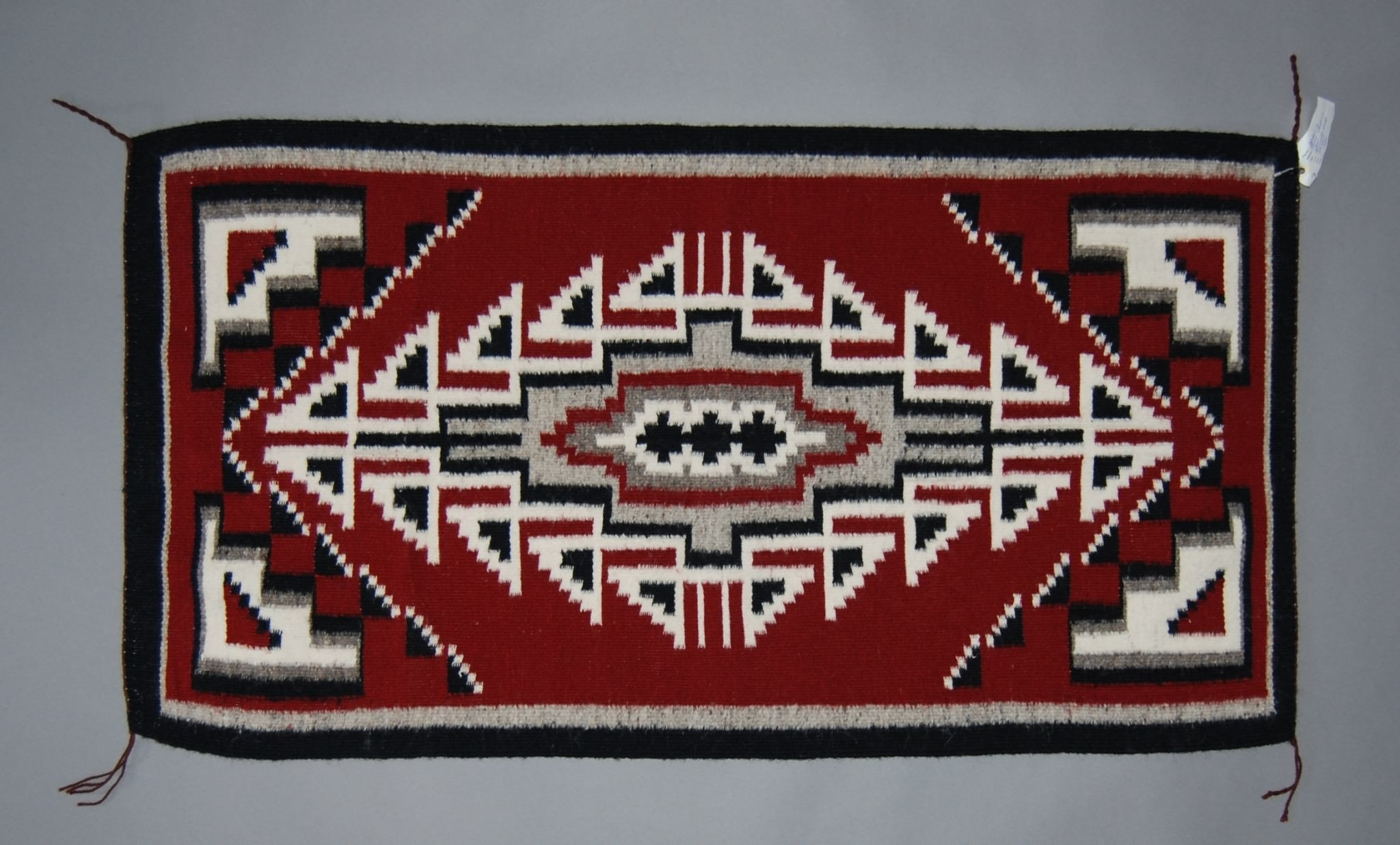 Navajo Weaving, Ganado Red by Lena Yozzie 24x47