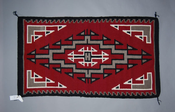 Navajo Weaving, Ganado by Stella Ashley 30x52