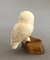 Owl on Fossilized Mammoth Tooth Base by Michael Slwooko