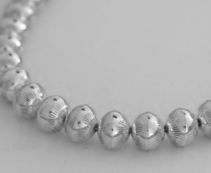 """Navajo Pearls"" 20"" Necklace with Stamped Beads by Jeffrey Nelson (Navajo)"