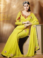 Shop Online for designer Indian Sarees. This stunning designer Saree is made in bright yellow Georgette fabric with red & golden details on the matching pallu & borders. This outfit also includes an embroidered unstitched blouse in Satin fabric. Wear it on any special occasion for a beautiful ethnic look!