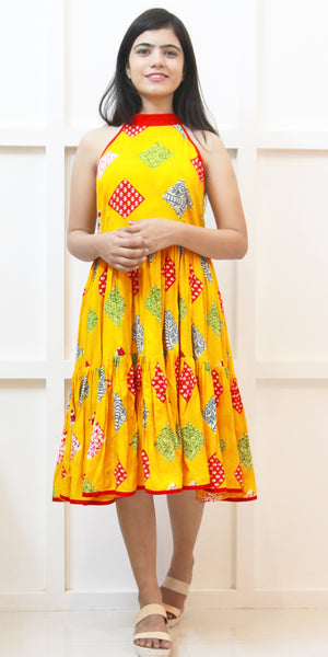 Shop online for designer Indo-western Boho midi dresses at the best rates in the USA & Canada. Knee length Halter Neck dress yellow red patchwork rayon. sleeveless matching border tiered fit flare frock style pleated Comfortable Unique ethnic Summer wear dress fashionable chic modern contemporary stylized Darpaha Sale