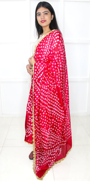 Buy designer Jaipuri Bandhani dupattas, stoles & chunnis at the best rates in the USA & Canada. Bright Hot Pink Art silk dupatta tie & dye Zari border. Rajasthani Ethnic Indian traditional wedding party festival fashion suit wrap accessories handloom light elegant handwork trendy anniversary design stylish shop online