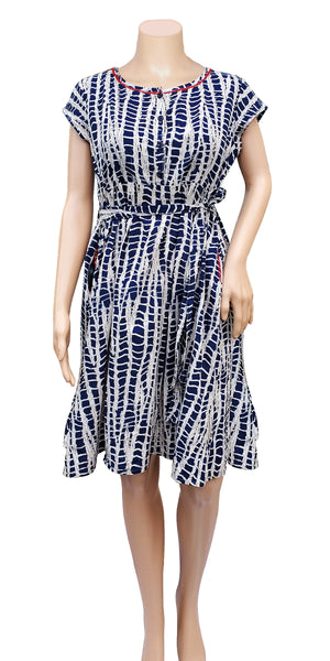Shop online for designer Indo-western Boho midi dresses at the best rates in the USA & Canada. Long dress white indigo batik print on pure cotton. Below knee length cap sleeves fit & flare pockets frock style pleated Comfortable Unique ethnic Summer wear dress fashionable chic modern contemporary stylized Darpaha Sale