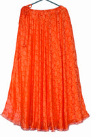 Shop online for designer Indian Banarasi Lehenga skirts at the best rates in USA & Canada. Bright Carrot Orange Art Jacquard Silk flared skirt floral pattern solid umbrella cut drawstring closure waist ankle floor length chanderi ethnic traditional festivals wedding party multicolor bridesmaid shiny Sale Darpaha