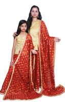 Buy designer mother & daughter combo Indian phulkari lehenga dresses at the best rates in the USA & Canada. Red Punjabi Phulkari Umbrella cut skirt & dupatta with sequins & mirror work 3/4 sleeve golden short kurti flared Ethnic traditional wedding party  festival occasion ethnic bridesmaid shop online Darpaha Sale