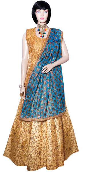 This stunning & elegant Lehenga Choli Set consists of a beige sleeveless banarasi silk blouse & skirt with heavy golden embroidery and mirror work.It is fashioned with a glittering sky-blue phulkari dupatta with matching lace borders. Make a statement with this stunning outfit at any festival, party or occasion! Base Banarasi Art Silk Fully Stitched Dry clean Please feel free to contact us to customize this outfit or add a matching stole/dupatta.Product color may slightly differ from the image.