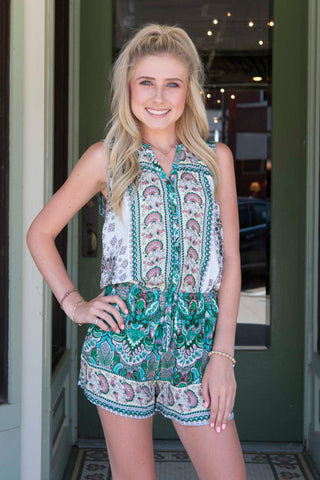 Green sleeveless white romper