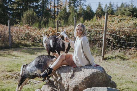 Alicia at home with her goats