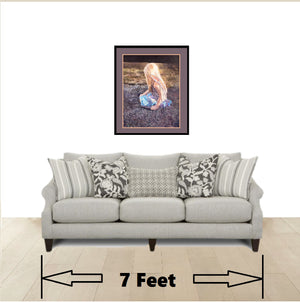 Beautiful framed fairy wall art print in living room above a couch
