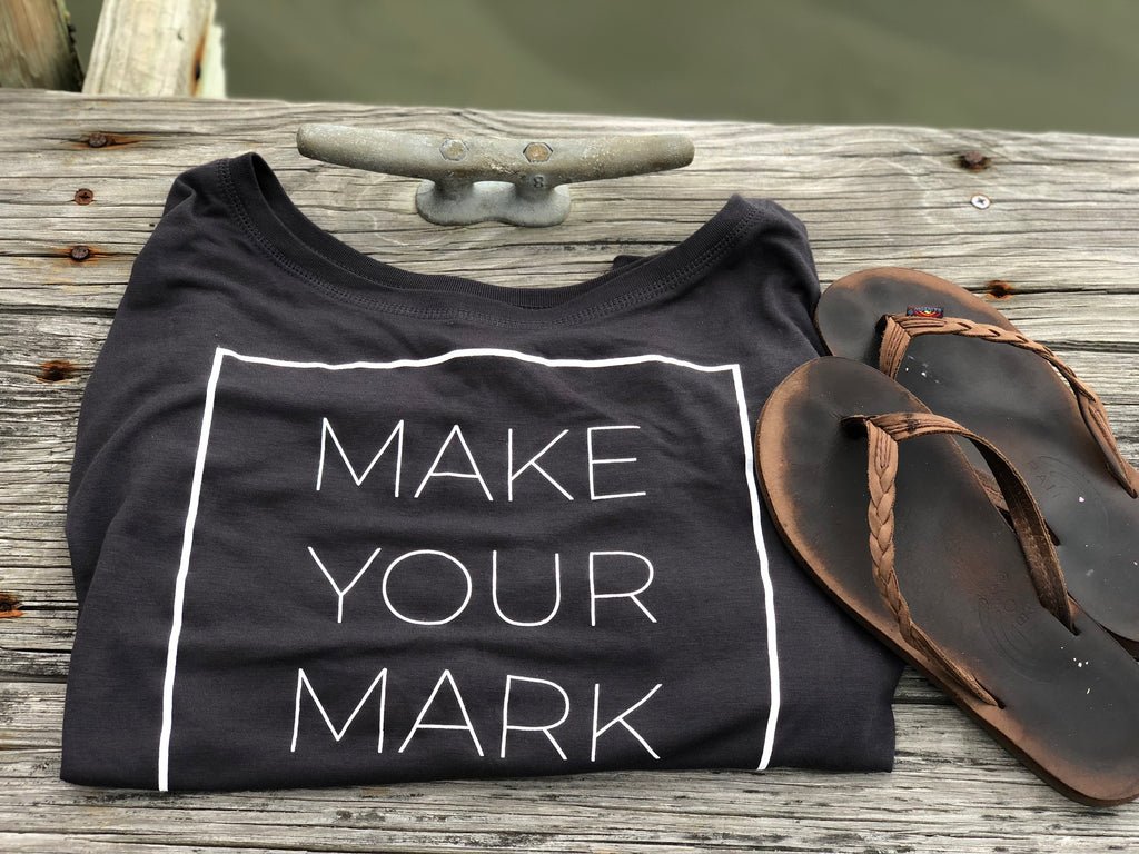 Make Your Mark Marker Nine ladies flowy t shirt on pier with flips flops.