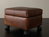 BRONZE FOOTED LEATHER OTTOMAN