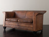 FIN ARMED LEATHER SETTEE BY BART VAN BEKHOVEN