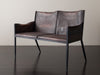 LEATHER AND IRON SETTEE IN THE STYLE OF JEAN-MICHEL FRANK