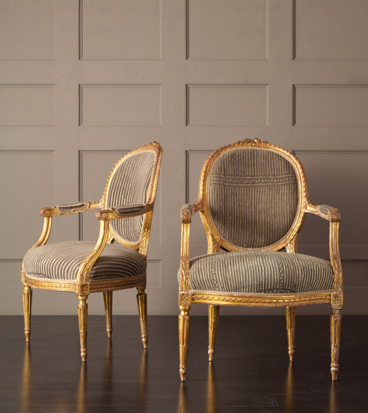 Pair of Louis the XVI Carved and Gilded Chairs with Antique African upholstery