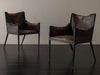PAIR OF LOUNGE CHAIRS IN THE MANNER OF JEAN MICHEL FRANK