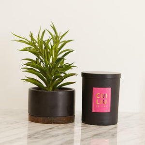 cui liu designs candle with pink label