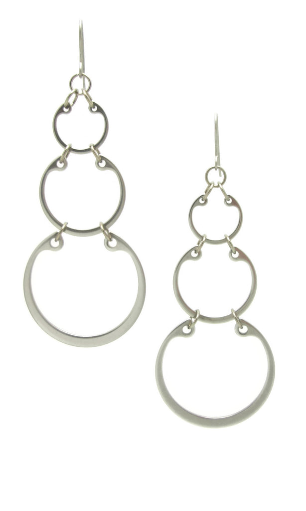 Graduated linked circles statement earrings by Wraptillion; always classic, never boring.