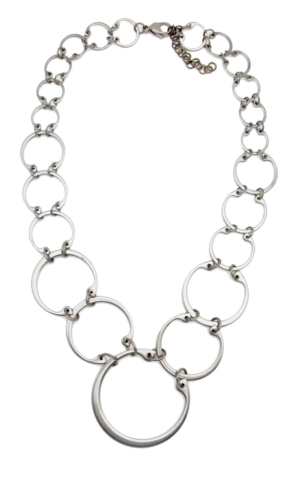 Graduated linked circles statement necklace by Wraptillion; always classic, never boring.