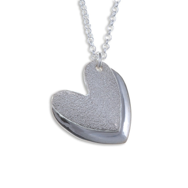 Two textured heart Silver pendant by St Justin
