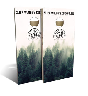 cornhole board set with foggy forest graphic