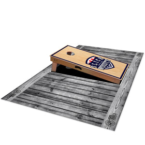 Slick Woody's Grey Barnwood Pitch Pad - side view with cornhole board on top