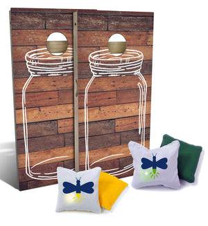 Front of two cornhole boards with vintage mason jar design, along with light-up cornhole bags with firefly design