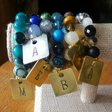 Custom hand stamped brass tags on beaded gemstone bracelets