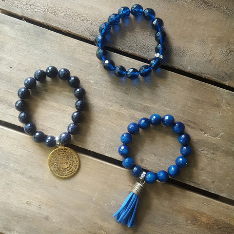 protection bracelets in deep blue colors 1 w tassel, 1 w Padre Nuestro lords prayer medal, 1 crystals