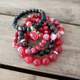 a pile of bead bracelets in red & black colors 8mm to 12mm