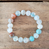 10mm pale aqua smooth fire agate bead bracelet