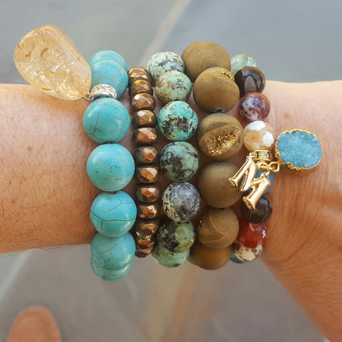 protection bracelets by Marinella Caribbean collection stacked on models wrist