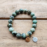 10mm turquoise beads bracelet with choice of brass or pewter tag that can be hand stamped w an initial of your choice