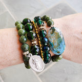 Emerald green jade stack of bracelets on wrist