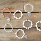 Protection bracelets by Marinella beaded crystal or stone 10-12mm adorned w various charms medals